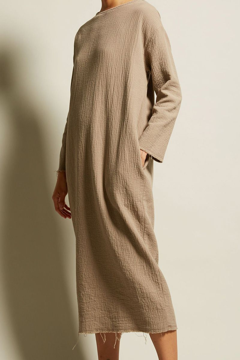 A dress with an undone hem style design and robes