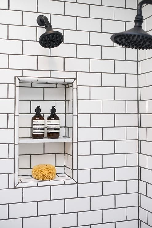 Fantastic Walk In Shower Features Walls Clad In White Subway Tiles Finished With Black Grout White Bathroom Designs White Bathroom Tiles Bathroom Tile Designs