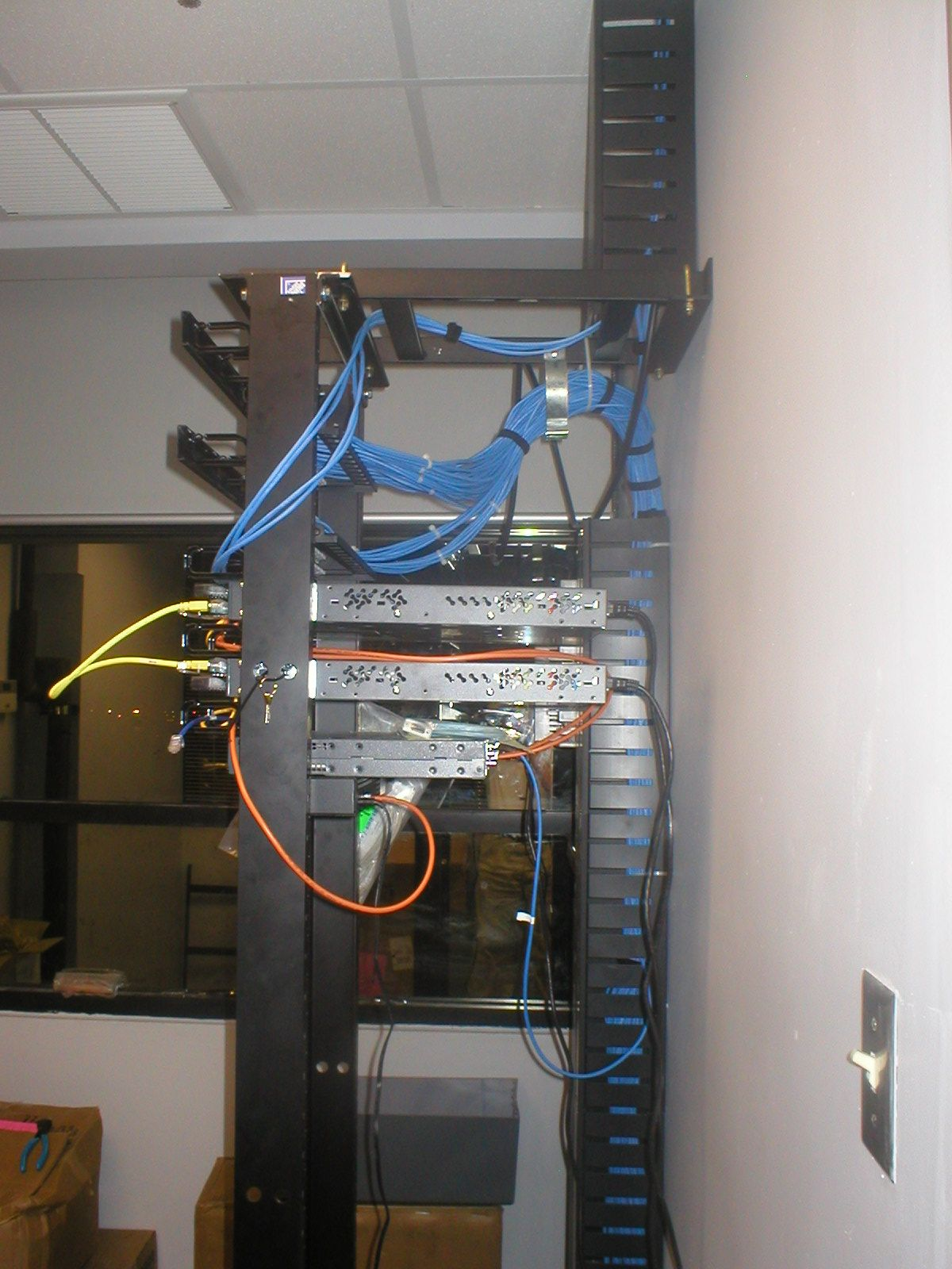 Side view of Data communications and telecom rack | we have