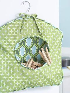 Inspiration only cool idea to repurpose a wire clothes hanger into add a dose of handy diy storage to your laundry room or mudroom with this fabric clothespin caddy solutioingenieria Choice Image