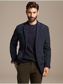 Dress up a casual shirt or sweater with a blazer.