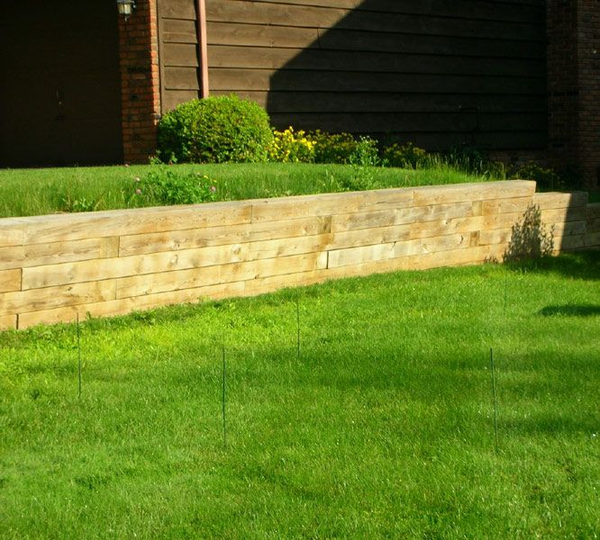 Railroad Ties Retaining Wall. It is a little plain. Needs a flower ...