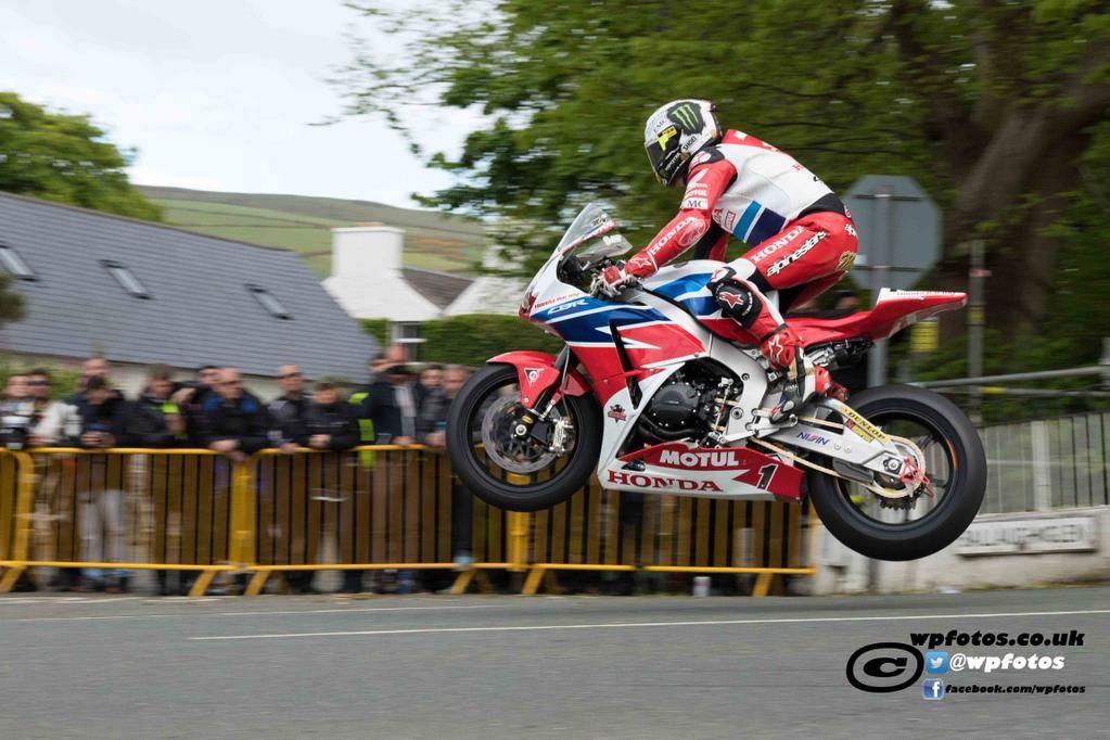 Red Torpedo On Wheel In The Sky Road Racing Super Bikes