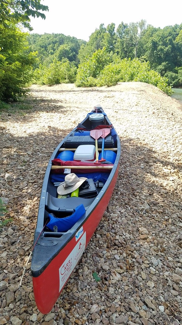 Photo of Old Town Canoe packed with camping gear. Most of it fit inside 3 recycled food b…