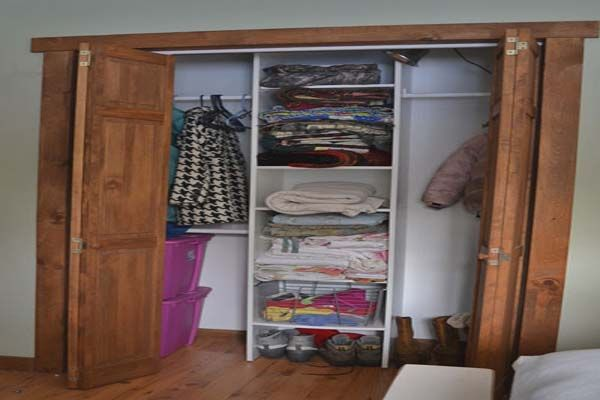 Rustic Closet Ideas For Small Bedrooms With Wood Folding Door Traditional Bedroom Interior Wooden Floor