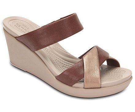 a132c70ac838 Women s Crocs Leigh-Ann Leather Wedge - Angle
