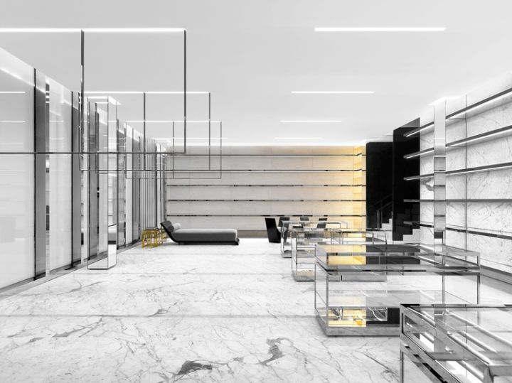 Although slabs of white and black marble, polished brass elements and plenty of glass still dominate the palette, the retail setting looks slightly tweaked under current creative honcho Anthony Vaccarello.