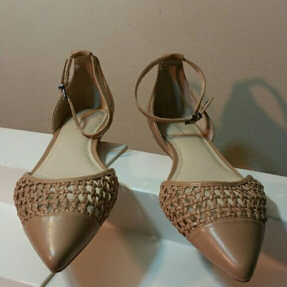"""BCBG Flat Woven detailing and a chic ankle strap make this flat stand out amongst the rest! The Hunny from BCBGeneration is ideal for casual weekends with friends!  Faux leather upper Ankle strap with an adjustable buckle Woven detailing Pointed cap toe?""""  covered sliver wedge heel Synthetic sole  Color : warm sand Imported BCBG Shoes Flats & Loafers"""