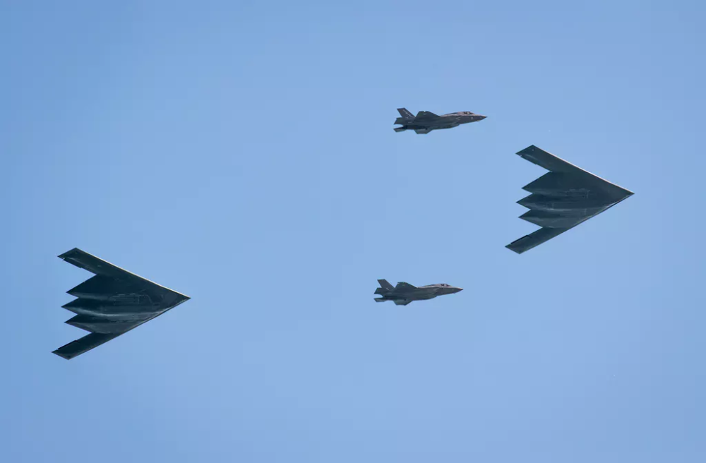 IN PICTURES British F35 jets fly with American B2