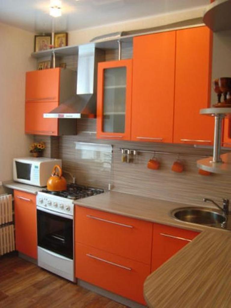 Cute orange kitchen cabinet for best kitchen colour combinations