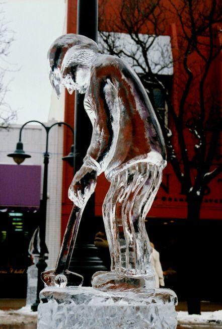 ice impressions michigan ice festival golfer putting ice sculpture