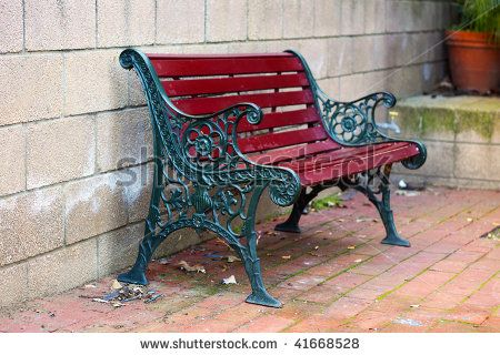 iron and wood garden bench painted green and red with small depth of field by cloudia spinner. Black Bedroom Furniture Sets. Home Design Ideas