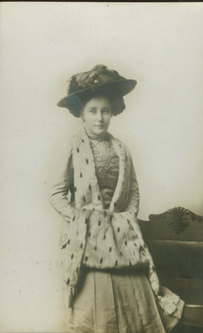 Real photo postcard of a presumably very wealthy young woman in ermine fur, circa 1910.