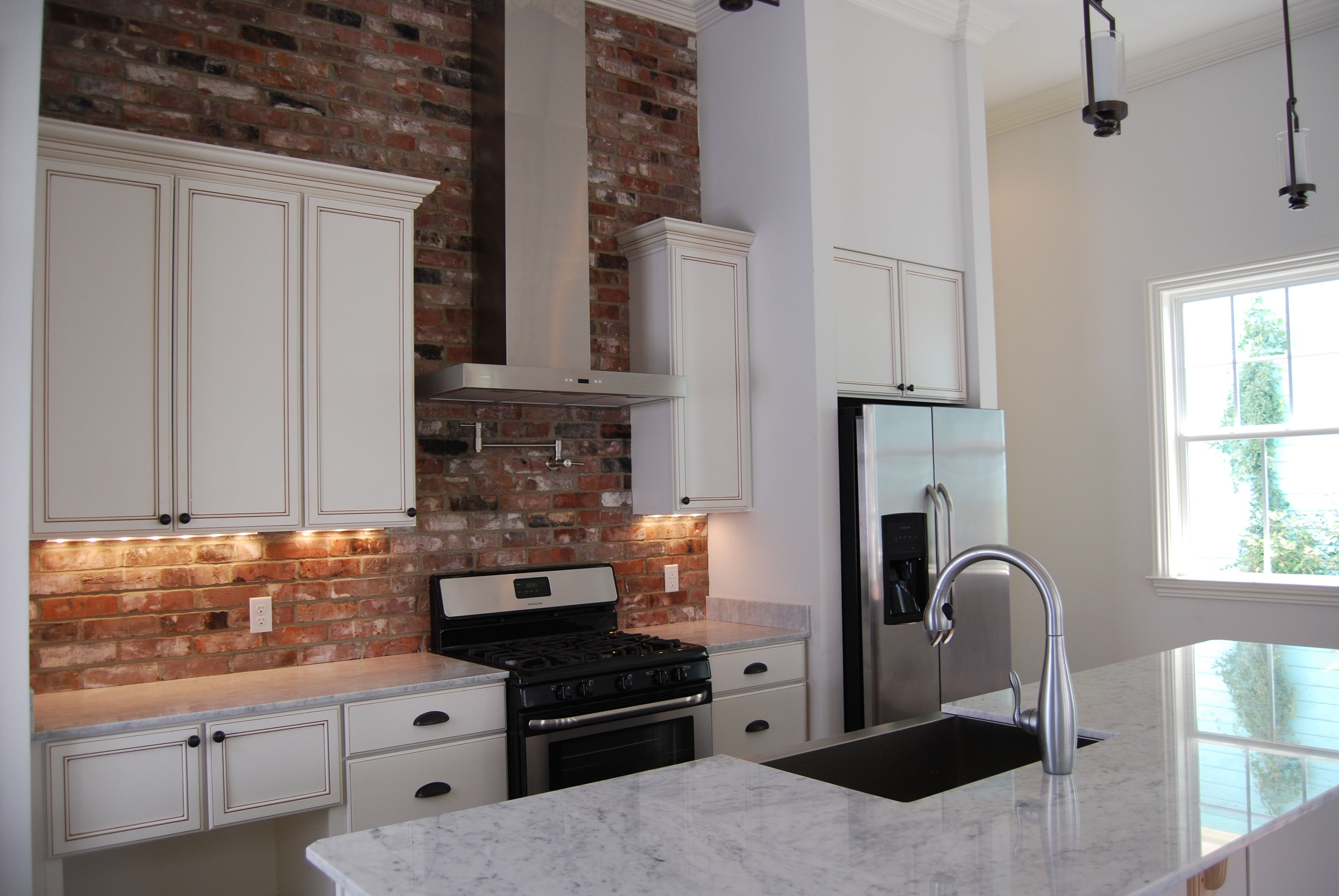 Solid Wood Cabinets With Mocha Glaze, White Carrara Marble Countertops,  Repurposed Old Chicago Brick Backsplash, Stainless Steel Appliances,  Brushed Nickel ...