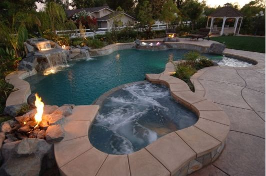 Tropical Inground Pool With A Hot Tub And Waterfall Backyard Pool Waterfalls Backyard Pool Pool Landscaping
