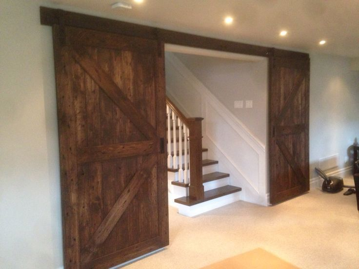 Photo of Beautiful Union Jack biparting barn door for a basement recreational room in a n,  #barn #bas…
