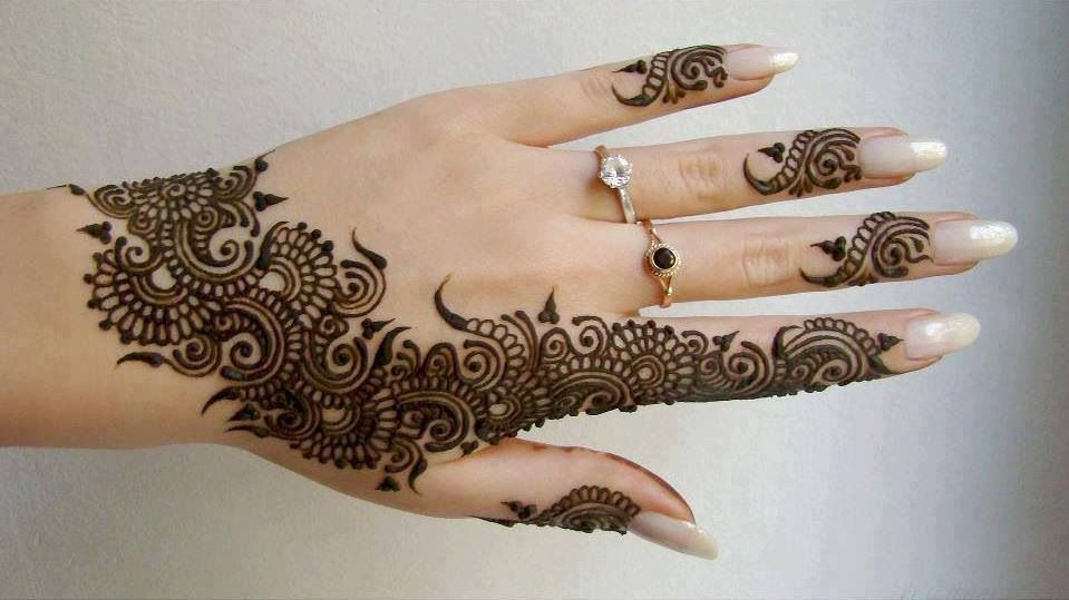 Mehndi and gold-tipped nails.