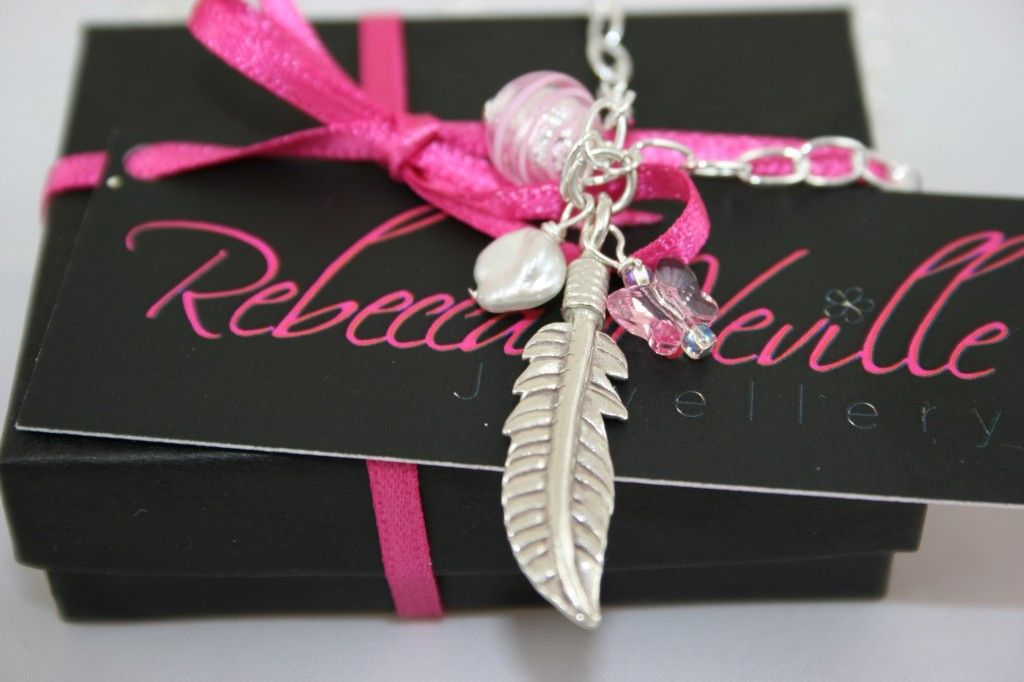 """Sterling silver chain, with a sterling silver feather, Murano glass, Freshwater Pearl and pale pink Swarovski Crystal butterfly. Approx 17"""""""