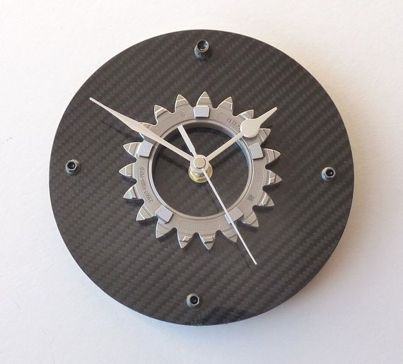 Hey, I found this really awesome Etsy listing at http://www.etsy.com/listing/117157257/carbon-fiber-formula-1-gear-wall-office