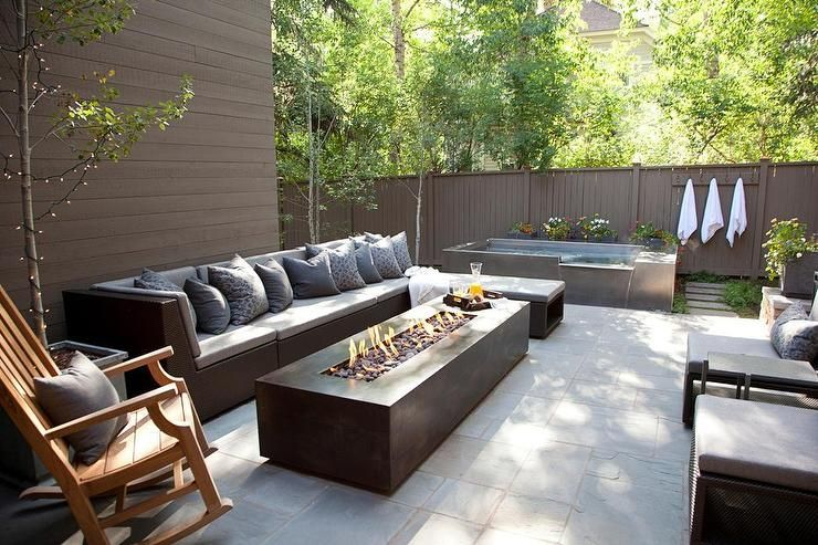 Modern Patio Features A Outdoor Sofa With Chaise Lounge Facing Long Fire Pit