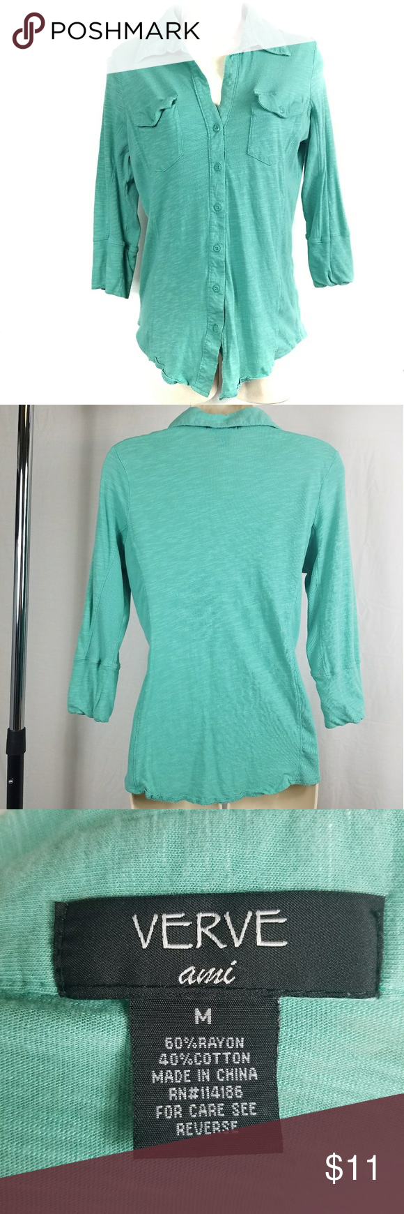"""VERVE ami Collared Button Down 3/4 Sleeve This VERVE ami women's size medium shirt has 3/4 length sleeves, button down front with two small pockets, and is in very good preowned condition.  All measurements aredone with item laying flat, not stretched,and are of the front of the item only.Measurements may vary by up to 1/2"""".  Shoulder width: 16"""" Bust: 19"""" Length: 25"""" (front collar to bottom hem) Hem: 19"""" Verve Ami Tops Button Down Shirts"""