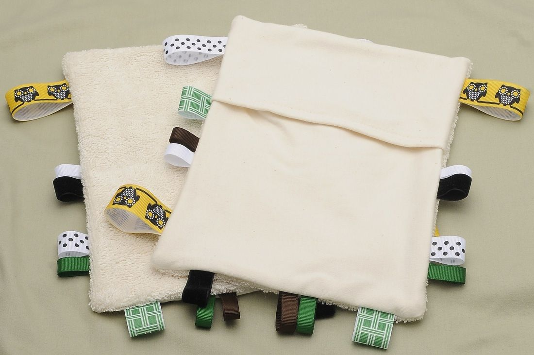 """Gift Ideas for Baby Showers: Organic Newborn Accessories - burp cloths, drool bibs, teething cloths, nursing pads, and this """"Lovey Bag.""""  Love their Stuff!"""