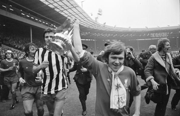 THE SUN OUT Liverpool players John Toshack and Brian Hall parade the winning trophy after the 1974 FA Cup Final between Liverpool and Newcastle...