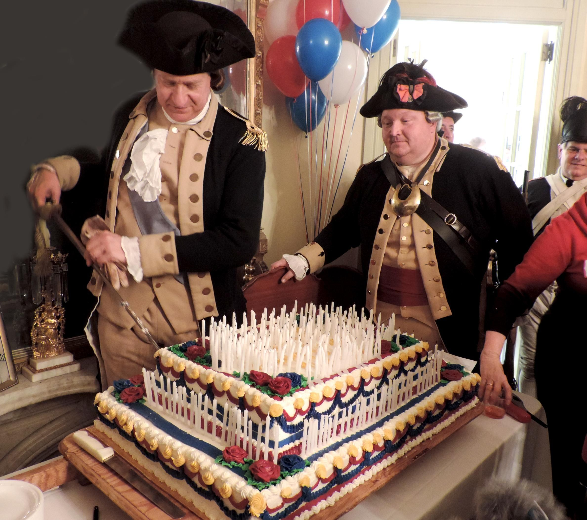 Using A Sword George Washington John Godzieba Cuts The First Piece Of His Birthday Cake Photo By Petra Chesner Schlatter
