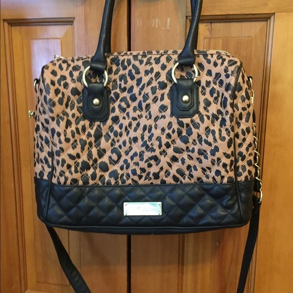 Handbag Leopard Betsey Johnson handbag. I've never used this bag. It has a really great shape and a lot of room. Betsey Johnson Bags Satchels