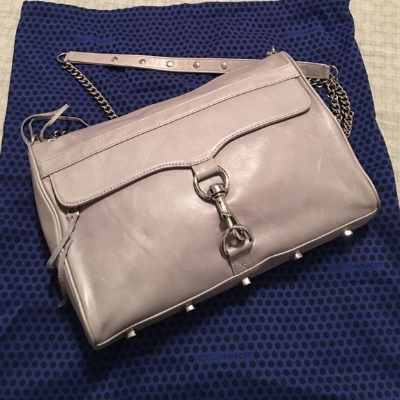 NWT Rebecca Minkoff MAC DADDY bag! NWT. Gorgeous gray leather, Unmistakable style infuses leather crossbody accented with an oversized clip-lock, dangling zip pull and optional strap. An interior padded pocket makes it perfect for transporting your iPad. Top zip closure. Height: 9in / 23cm Length: 13in / 33cm Depth: 2in / 5cm Strap drop: 21in / 53cm (NOTE: bottom feet have a bit of scratching due to handling) TV $400 Rebecca Minkoff Bags Crossbody Bags