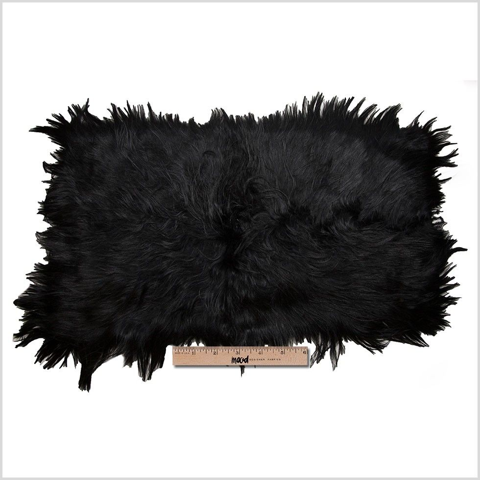 Luscious, long and lavish, Mood presents the first long haired goat hide ever to reach our online department. Faced with luminous free-flowing hairs, this high-quality fur is one you will never want to let go of. On the back side of this material remains a grid of 12 thick and crisp suede patches sewn together forming a perfectly rectangular hide. For those who are not too familiar with the different types of leathers and suede, goat skins are known for being more durable than cow hides…