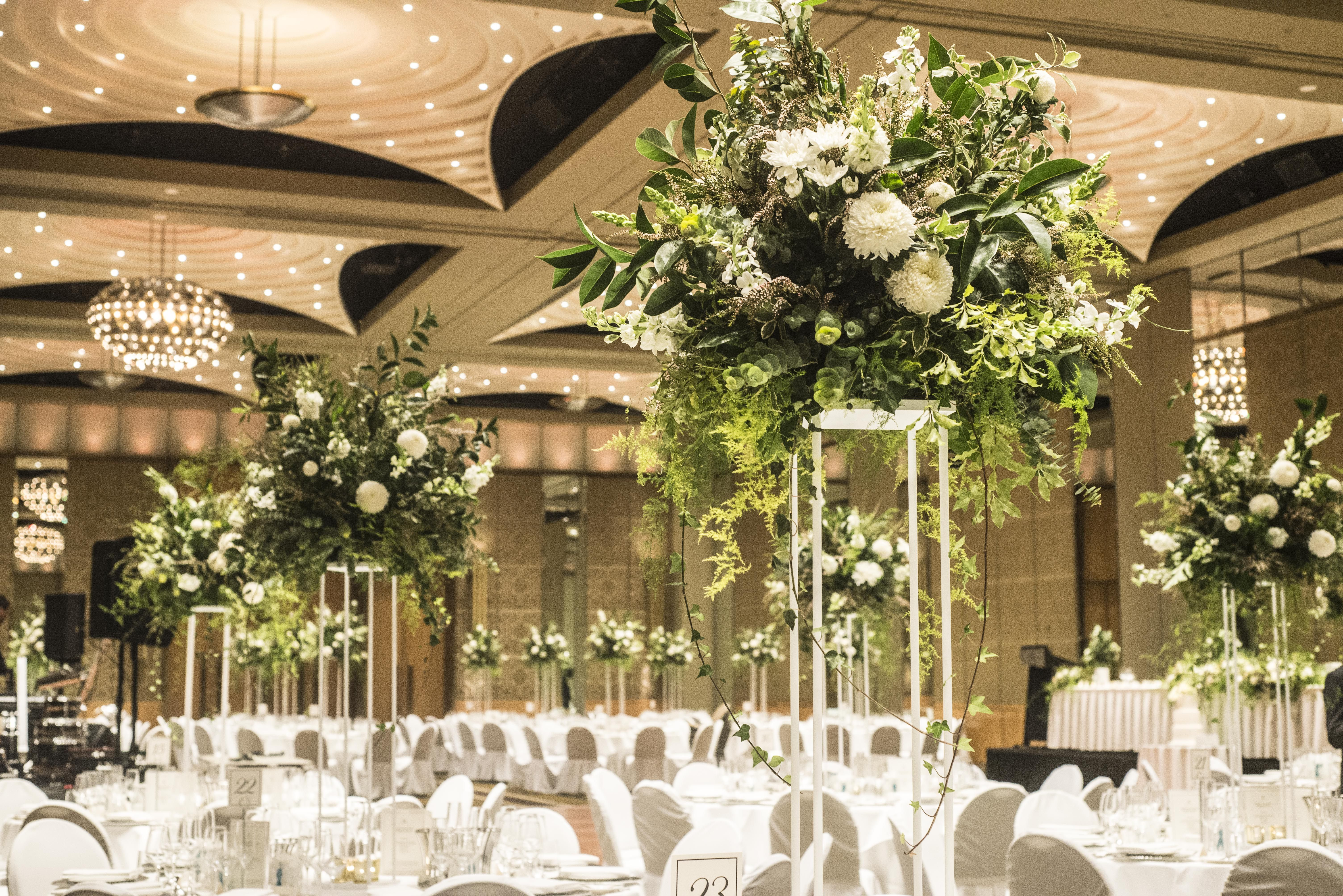 White And Green Floral Arrangements On Canopy Stands Wedding Reception Arrangements On Table Stands Fl Reception Arrangement Wedding Florist Wedding Flowers