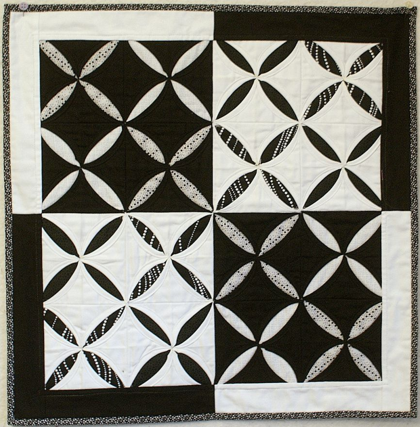 Cathedral Windows mini quilt by Celeste from CMQG, for Andie Johnson.  Reminiscent of the dark/light principle of Notan