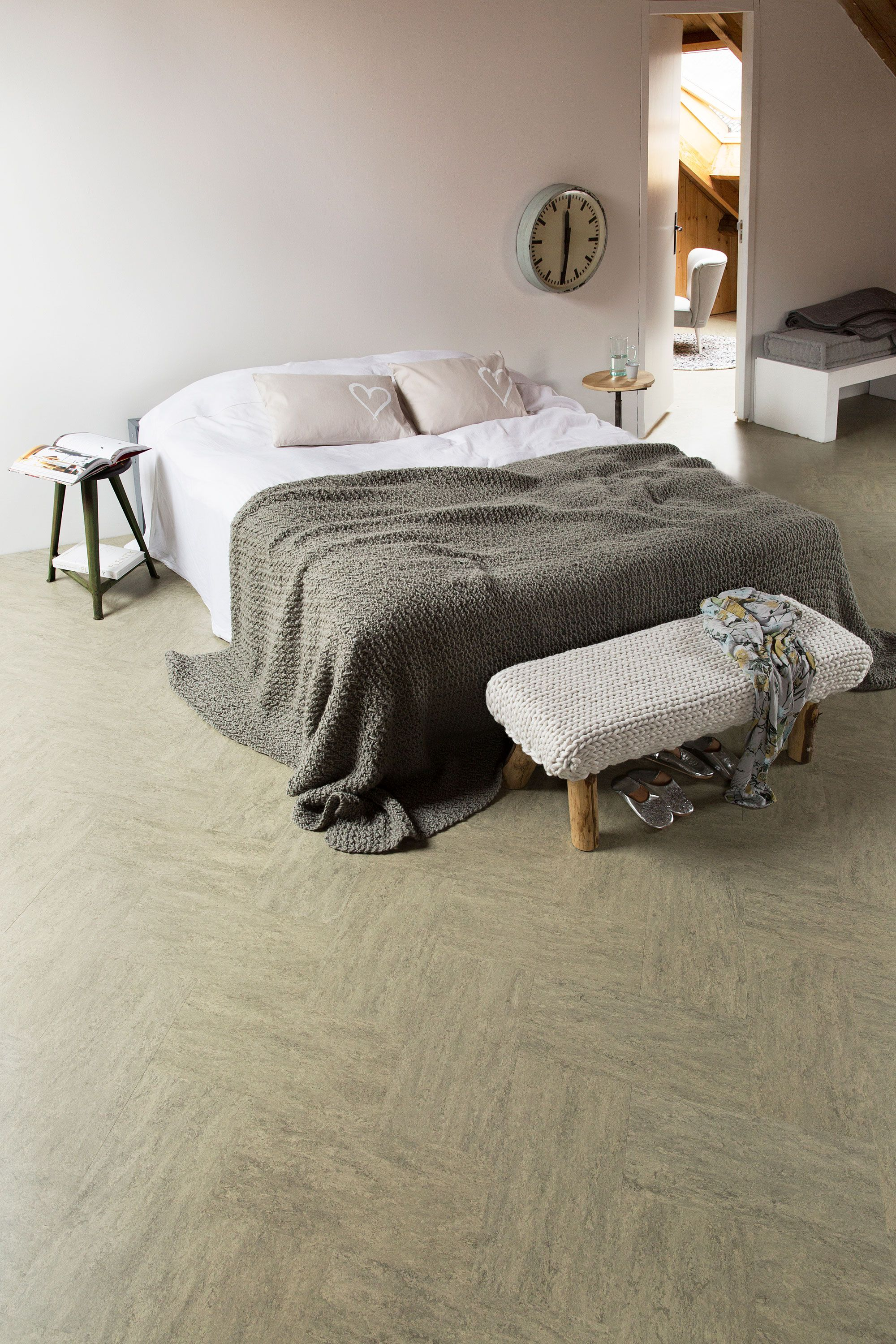 Bedroom With Marmoleum Marble Floor And A Cozy Bed With Pillow And Coverlet Photographer