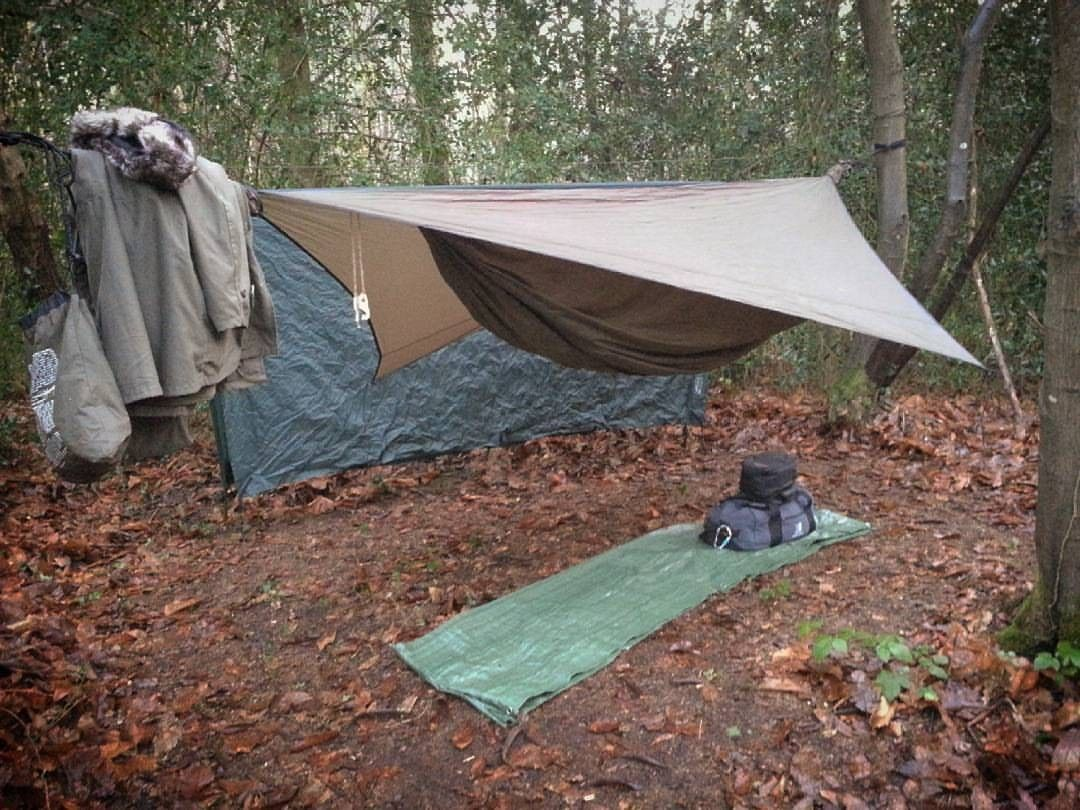 With dd 3x3 tarp behind as a wind break. repost: @island_bushcraft #offgrid  #hunting #fishing #camping #hiking #cabin #winter #snow #offgridmovement ...