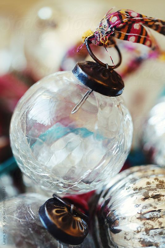 close up of a bowl full of vintage glass christmas baubles and vintage ribbons