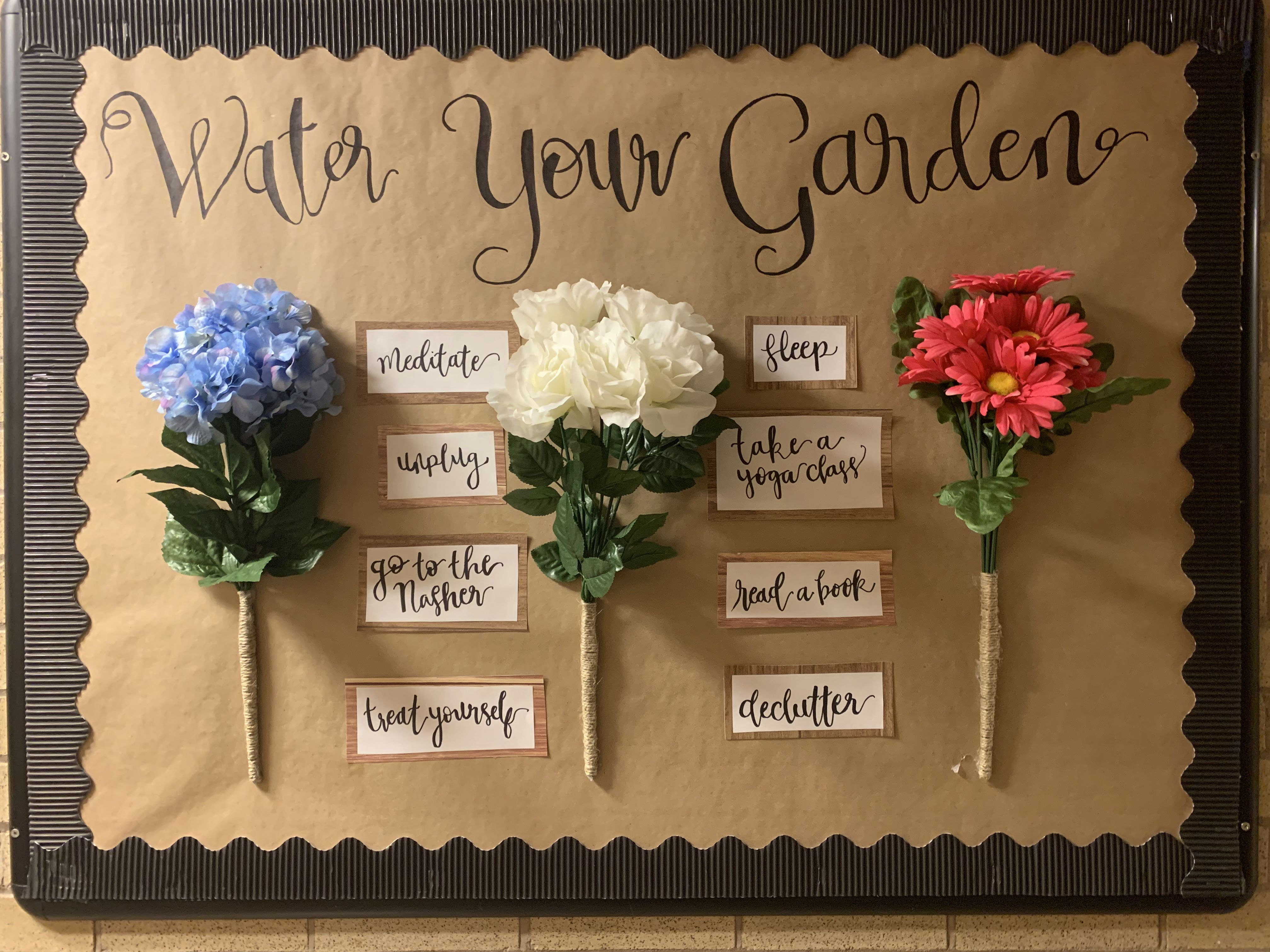 super simple spring RA bulletin board with flowers and tips for self-care #rabulletinboards