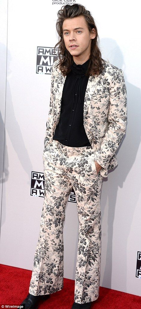 c82616d75a417 Standing out  One Direction s Harry Styles wowed in a floral flared Gucci  suit with black floral blouse