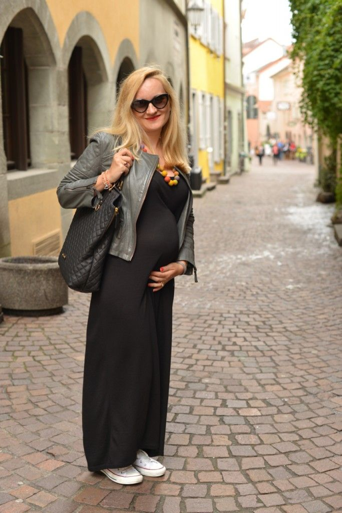 Basic black maxi dress, grey leather jacket and white sneakers for a maternity outfit