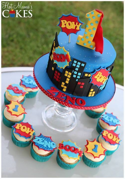Colorful Superhero Dessert Display With A Cake And Cupcakes