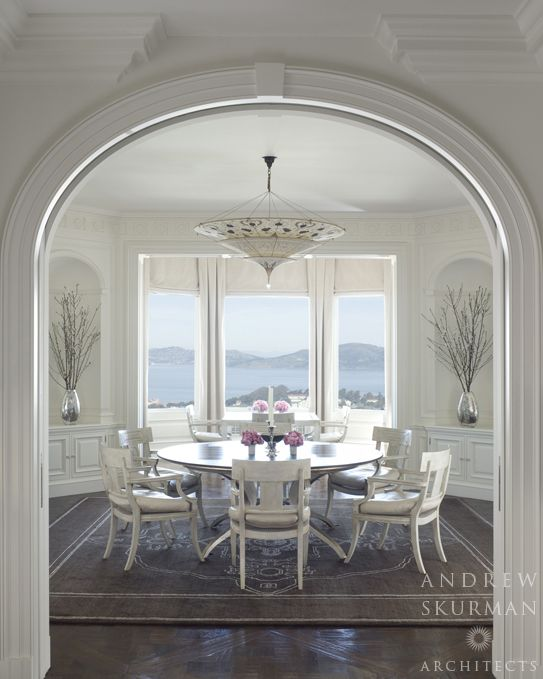 View from the kitchen to the octagonal dining room and view beyond. Photographer: David Duncan Livingston