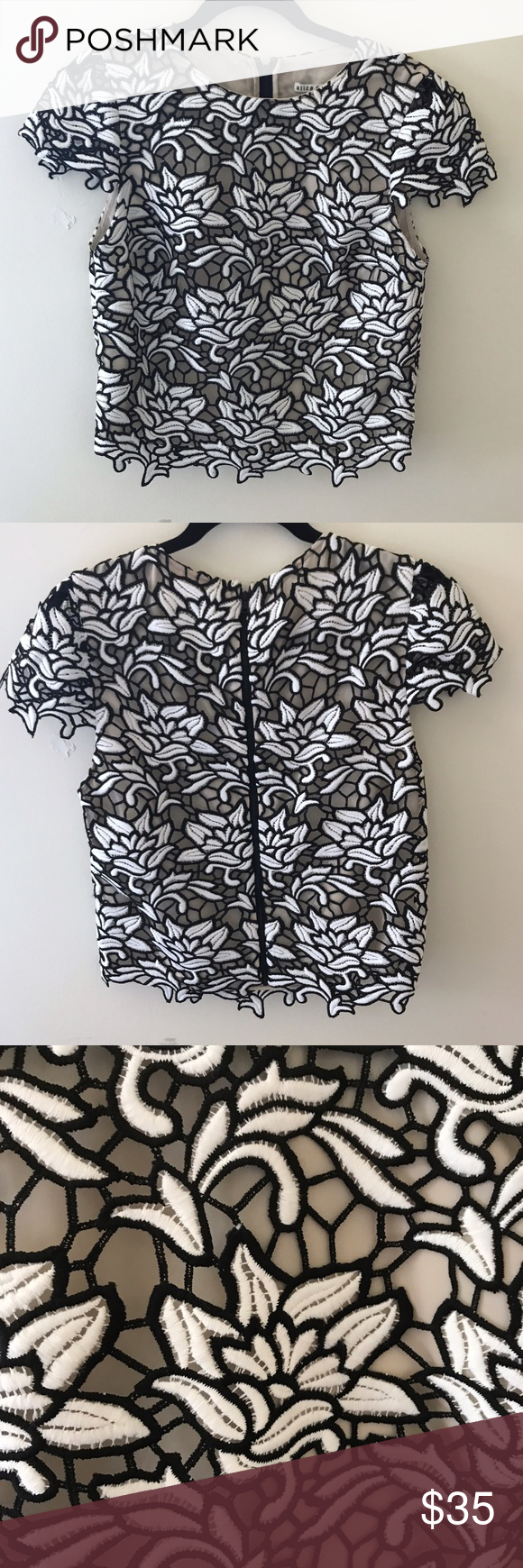 Alice and Olivia black and white lace top Zipper back. Silk lining Alice + Olivia Tops Blouses