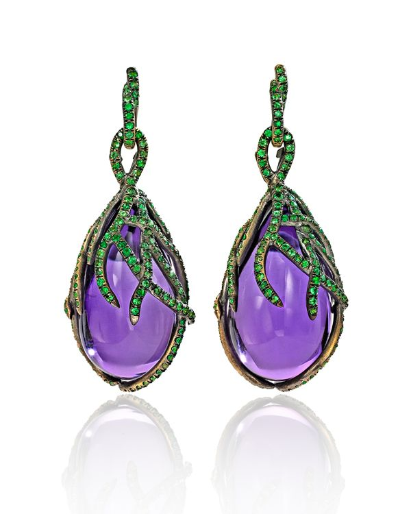 Wendy Brandes Amethyst Marie Antoinette Earrings for February    Ample custom-cut amethysts--each over 25 carats--wrapped in vines of pavé-set tsavorite garnets evoke the French monarchy's grip on the young queen.