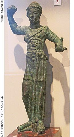 Bronze statuette of Menvra wearing the aegis and Gorgoneion. From central Italy. Circa 500 BC. Unusually, the head of the Gorgon is as large as that of the goddess, and her right rather than left leg is bent. The handle in her left hand and spigot on the forearm indicate where a shield was attached to the figure.  Altes Museum, Berlin.
