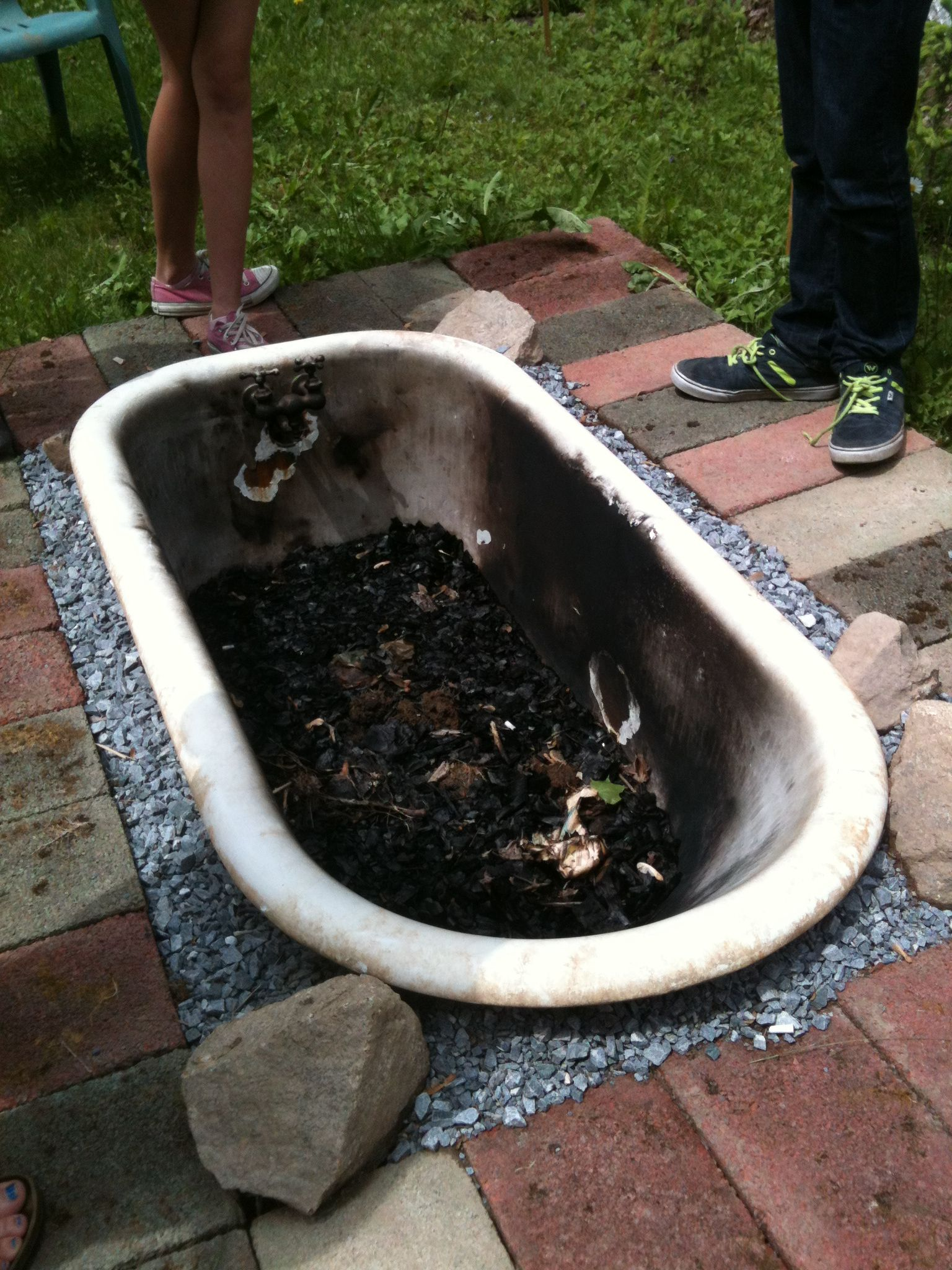 Put an old bathtub in the ground and use it as a firepit ...