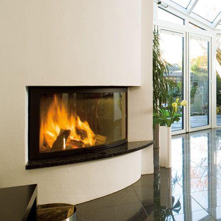 Ruegg Kamin rüegg cheminée ag liftdeurhaard ellipse fireplace in the living