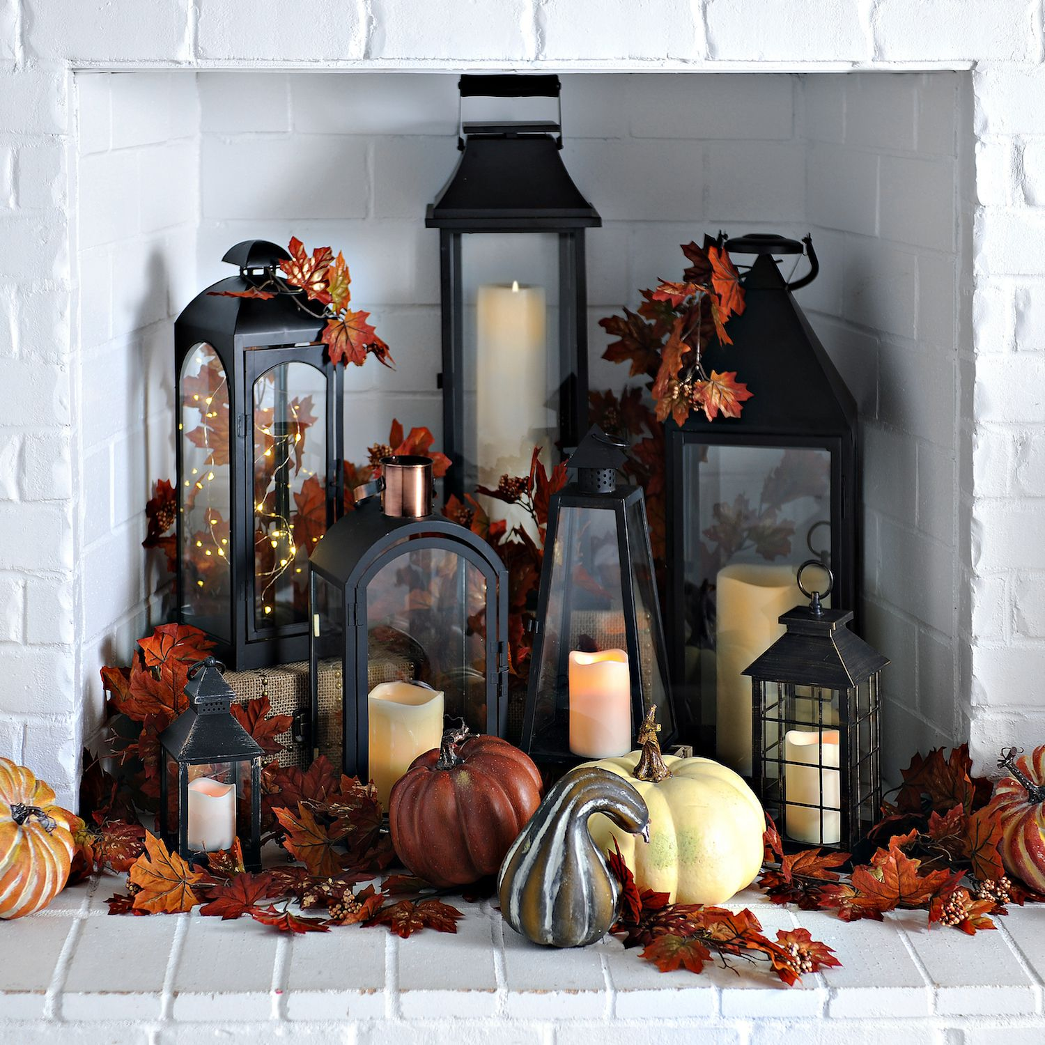 Use your fireplace as another space in your home to decorate for fall! Fill it with an array of lanterns and create a statement. You can also fill the lanterns with string lights, candles or leaves for a fall look! -   24 apartment fireplace decor ideas
