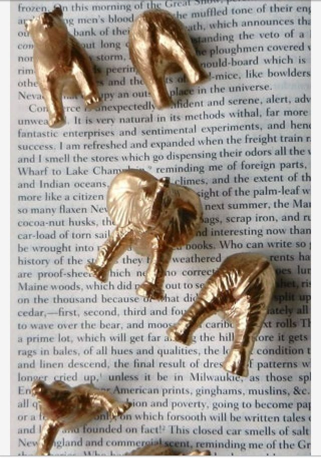 Dollar store animal figurines cut in half, spray painted gold with a magnet