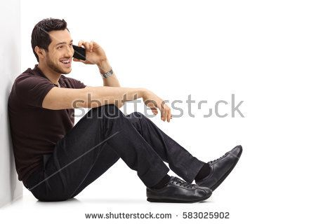 Young Man Talking On A Phone While Sitting On The Floor And Leaning Against A Wall Isolated On White Backgrou Pose Reference Photo Sitting Poses Pose Reference
