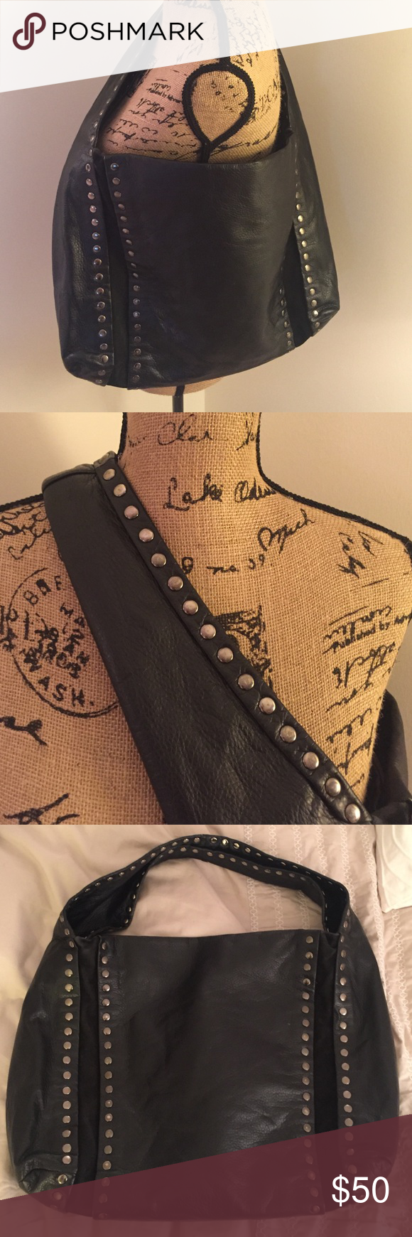 Big Buddha hobo bag Beautiful black leather Big Buddha handbag! Simple silver studs along the shoulder strap and down the front/back. Very soft leather, light pink interior with two inner zipper pockets and two small interior pockets. Some light stains on interior but in otherwise great condition! Bags Hobos